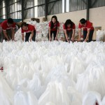 Coca-Cola employees in the Philippines pack relief goods for victims of Typhoon Haiyan Yolanda