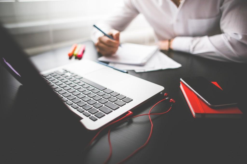 man working writing laptop