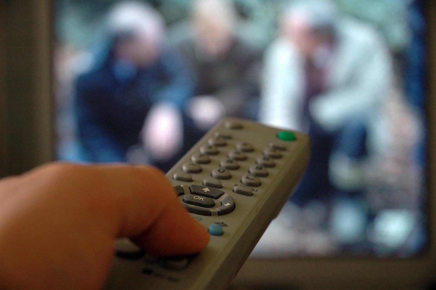 tv remote hand
