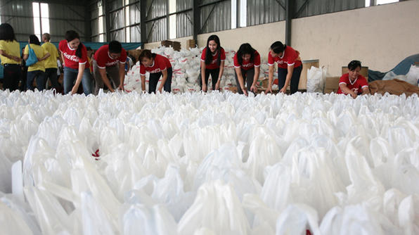 Coca Cola employees in the Philippines pack relief goods for victims of Typhoon Haiyan Yolanda