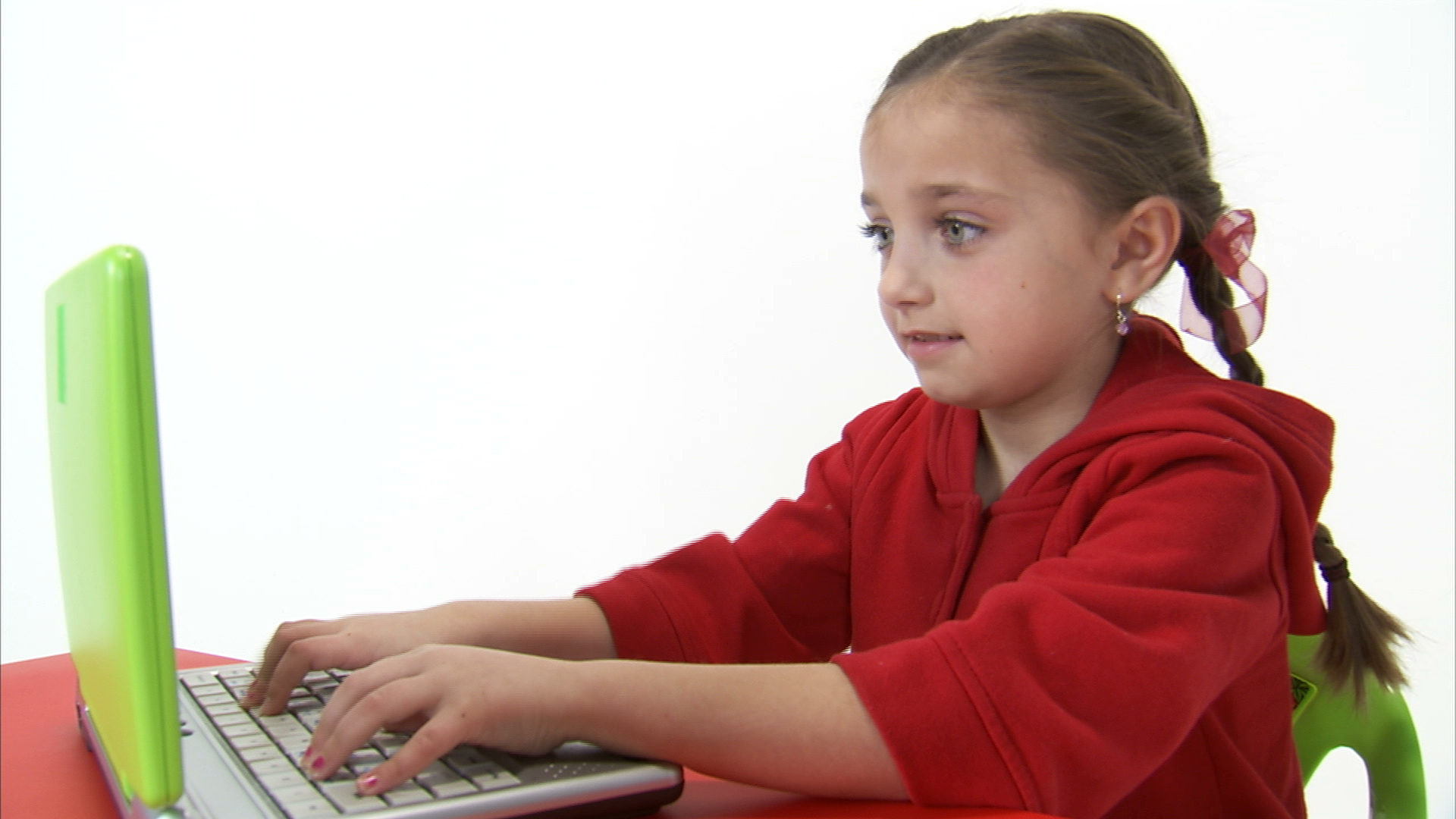 Eight Year Old Girl Working at the Computer